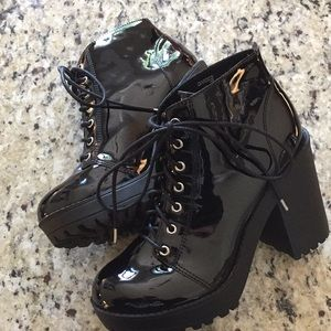 Black lace up boots, glossy, and barely used.